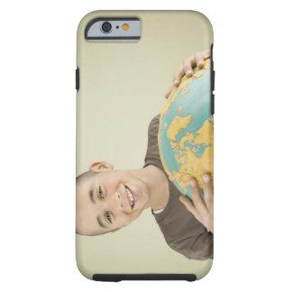 Muchacho que sostiene el globo funda de iPhone 6 tough