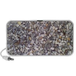 Muchas pequeñas piedras mini altavoces