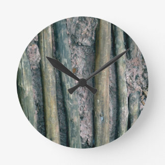 mud and wattle wall detail round clock
