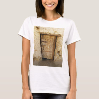 Mud Brick House with old Door  Siwa Oasis, Egypt T-Shirt