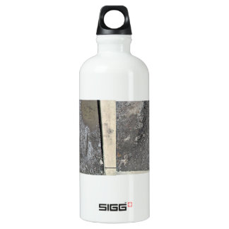Mud surface with some water SIGG traveler 0.6L water bottle