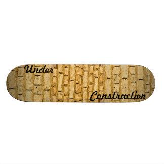 Muddy brick wall construction skateboard