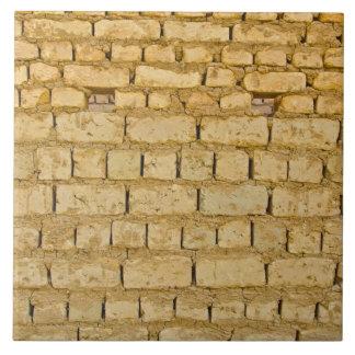 Muddy brick wall tile