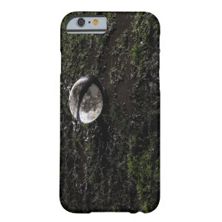 Muddy rugby ball sitting on a chewed up grass barely there iPhone 6 case