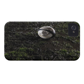 Muddy rugby ball sitting on a chewed up grass Case-Mate iPhone 4 case