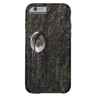 Muddy rugby ball sitting on a chewed up grass iPhone 6 case