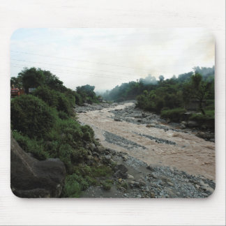 Muddy stream and smoke in Himalayas after rain Mousepads