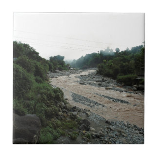 Muddy stream and smoke in Himalayas after rain Ceramic Tiles