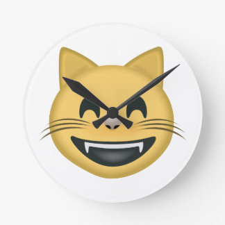 Mueca de la cara del gato con los ojos sonrientes relojes de pared
