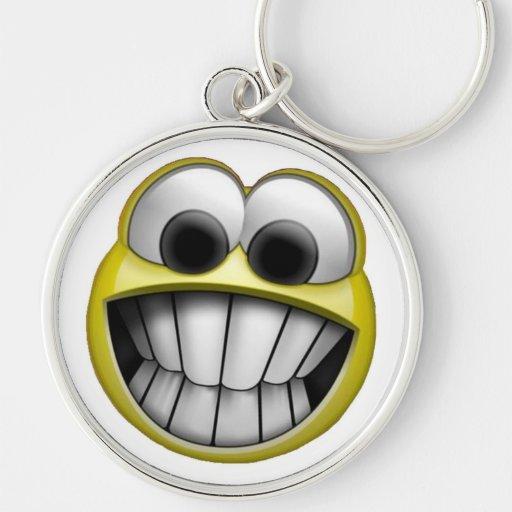 Mueca de la cara sonriente feliz llavero redondo plateado