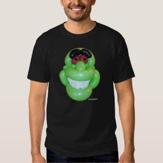 Mueca del monstruo verde del globo por estiramient playera