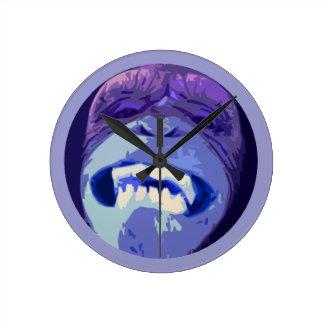 Mueca del reloj de pared de la cara del mono del c