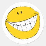 Mueca sonriente tonta de la cara etiqueta redonda