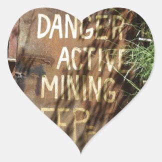 Muestra activa de la explotación minera pegatina en forma de corazón