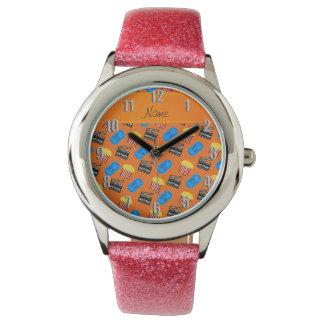 Muestra anaranjada conocida de la acción del relojes de pulsera