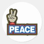 Muestra de la mano de la paz pegatina redonda