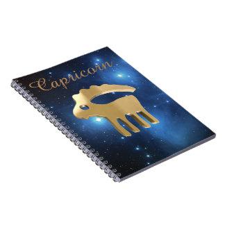 Muestra de oro del Capricornio Cuaderno