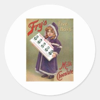 Muestra del anuncio del chocolate con leche de los etiqueta redonda
