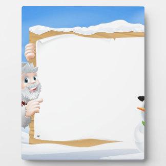 Muestra del dibujo animado del muñeco de nieve de  placa
