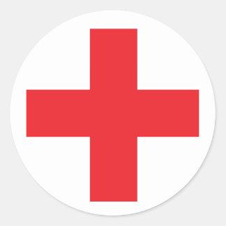 Muestra del equipo de primeros auxilios etiquetas redondas