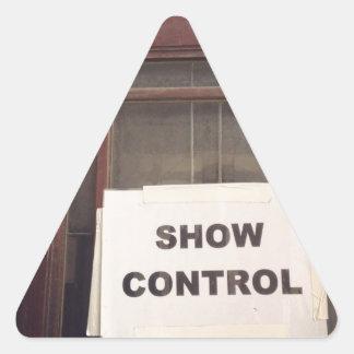 Muestre el control pegatina triangular