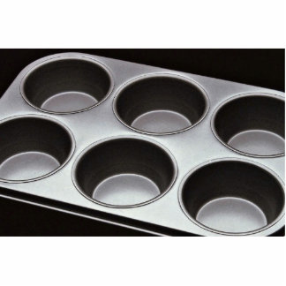 Muffin pan for home baking standing photo sculpture