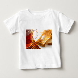 Mug of tea and hot toast with butter baby T-Shirt