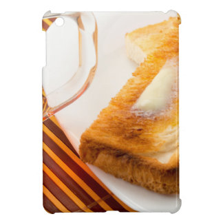 Mug of tea and hot toast with butter case for the iPad mini