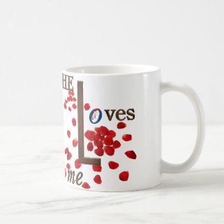 mug with love message on red rose petals