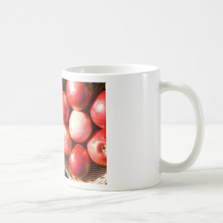 Mug with red apples.