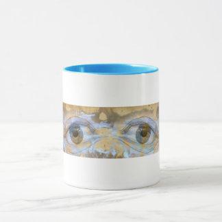Mug with sad eyes blended into a wall