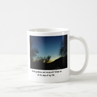Mug with Scripture and sunset framed in trees.