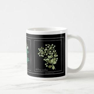 Mug with white prairie flowers.