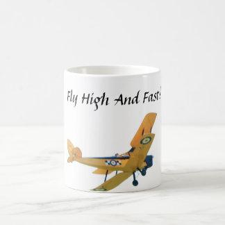 """Mug with yellow bi plane. Says """"Fly High and Fast"""""""