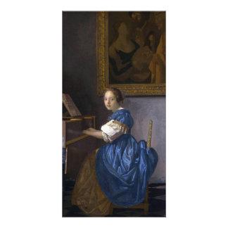 Mujer asentada en un Virginal por Vermeer Tarjetas Fotograficas