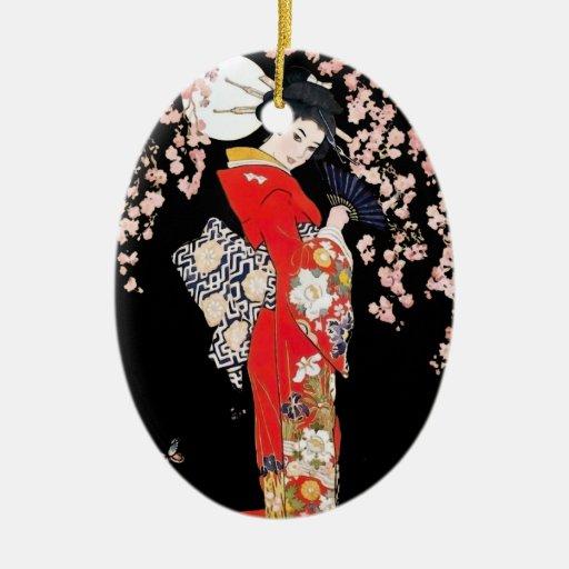 Mujer asiática con noche de la flor de cerezo ornamentos para reyes magos