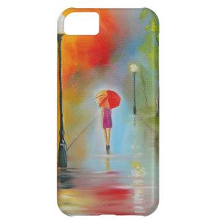 Mujer colorida con un paraguas rojo