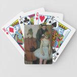 Mujer con dos niñas (en colores pastel) barajas de cartas