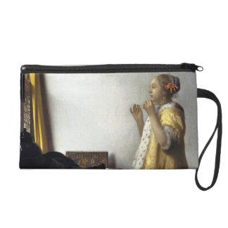 Mujer con el collar de la perla de Juan Vermeer