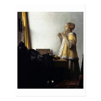 Mujer con el collar de la perla de Juan Vermeer Postal