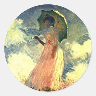 Mujer con el paraguas de los pegatinas de Claude Pegatina Redonda