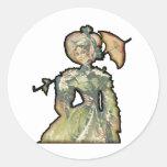 Mujer con el paraguas etiqueta redonda
