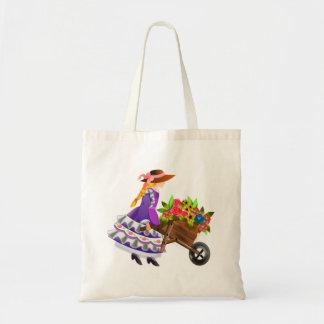Mujer con la carretilla de flores bolsas
