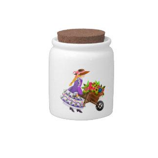 Mujer con la carretilla de flores platos para caramelos