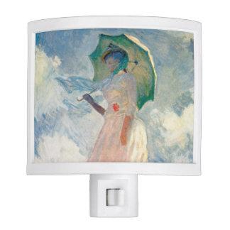 """Mujer con la """"promenade"""" Monet del parasol Luz De Noche"""