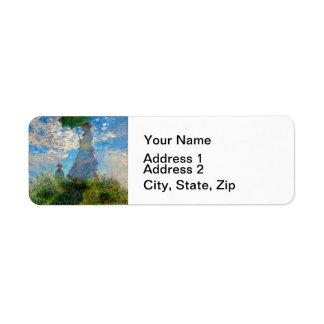 Mujer con un impresionista de Claude Monet del Etiquetas De Remite