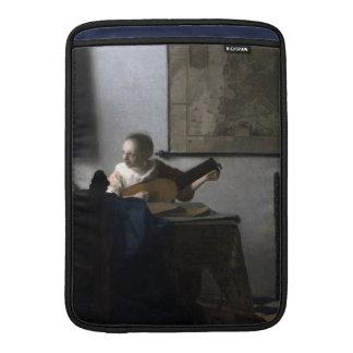 Mujer con un laúd de Juan Vermeer Fundas MacBook