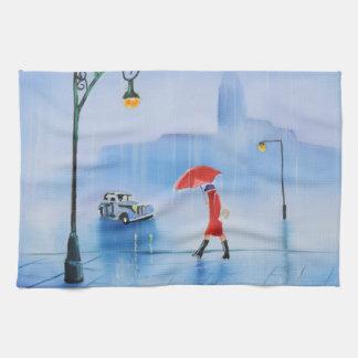 Mujer con un paraguas rojo en la lluvia toalla
