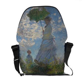 Mujer con un parasol de Claude Monet Bolsas De Mensajería