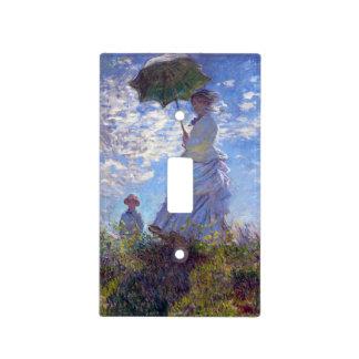 Mujer con un parasol placa para interruptor